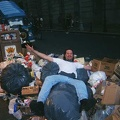 Chad flings himself into one of the many trash piles. Note the Mystery Machine in the background