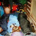 Fish Camp. Training Trek. It rained for several days so two training crews slept cozy on the porch of a Fish Camp cabin