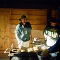 Ken Aldrich and Fred Hildebrand flipping pancakes at the breakfast chuckwagon at Ponil.